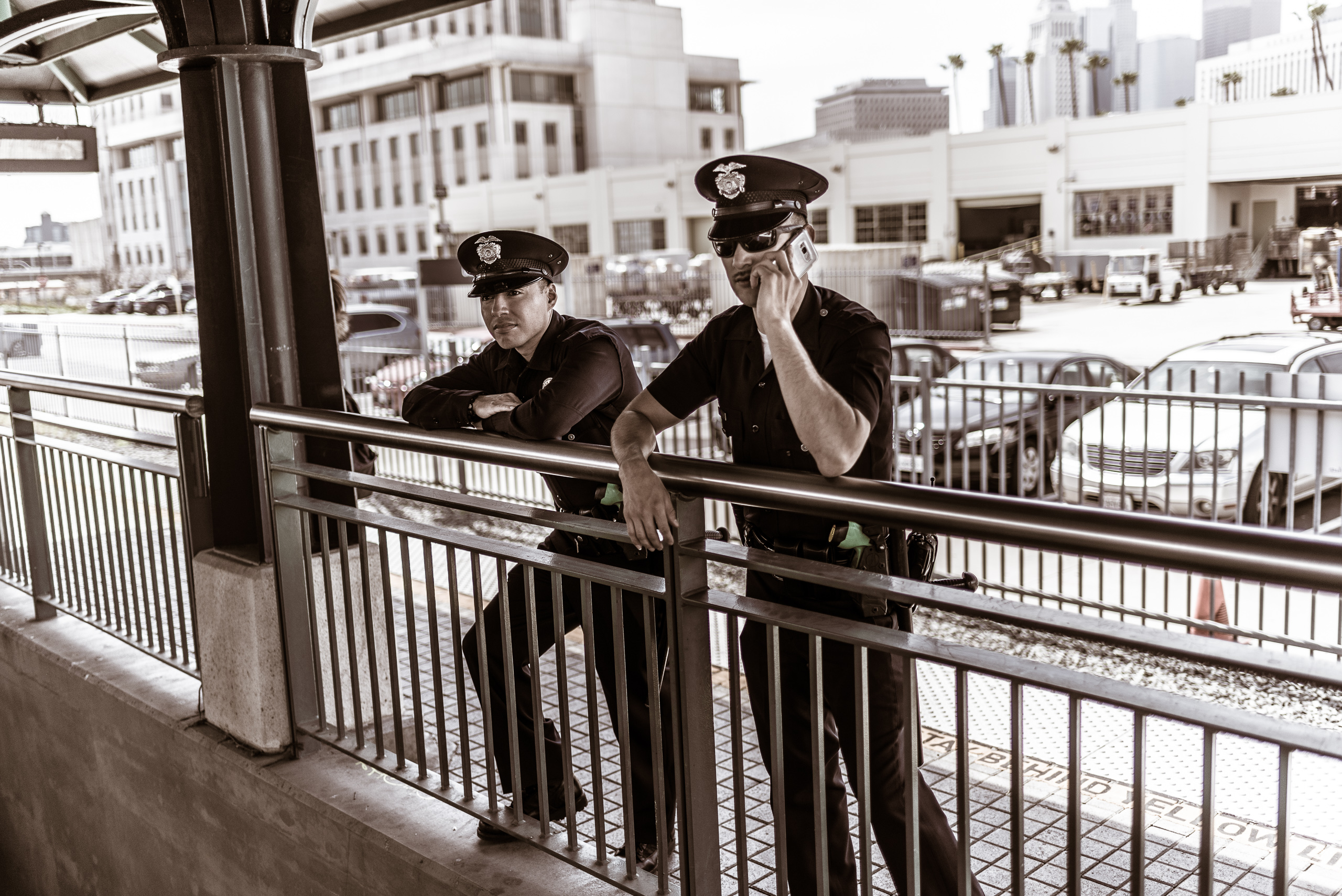 two LA Metro police officers lean on a rail on the Gold Line platform at Union Station in Downtown Los Angeles