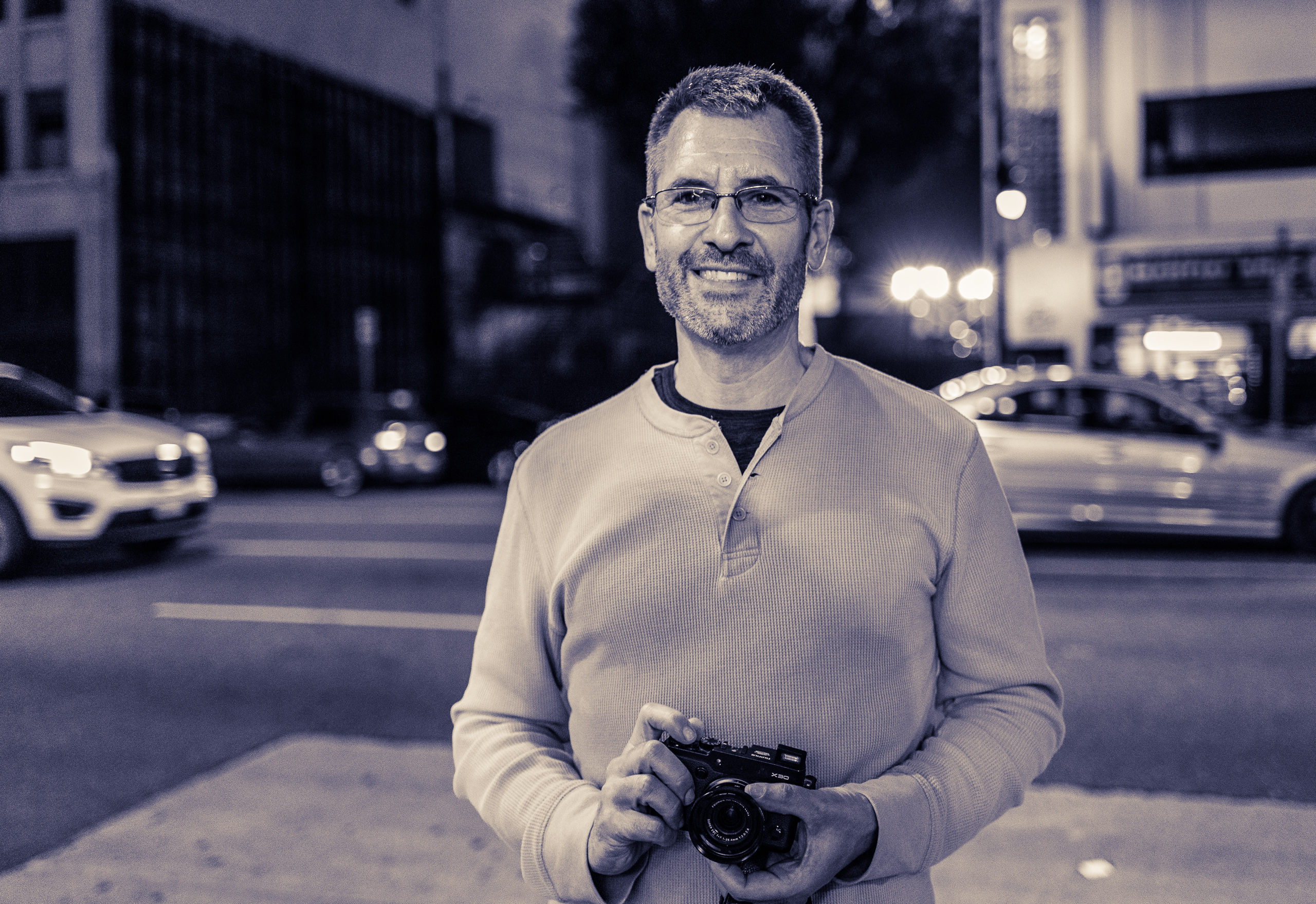 Rick Sanborn and his mirrorless Fuji camera on Hollywood Blvd.