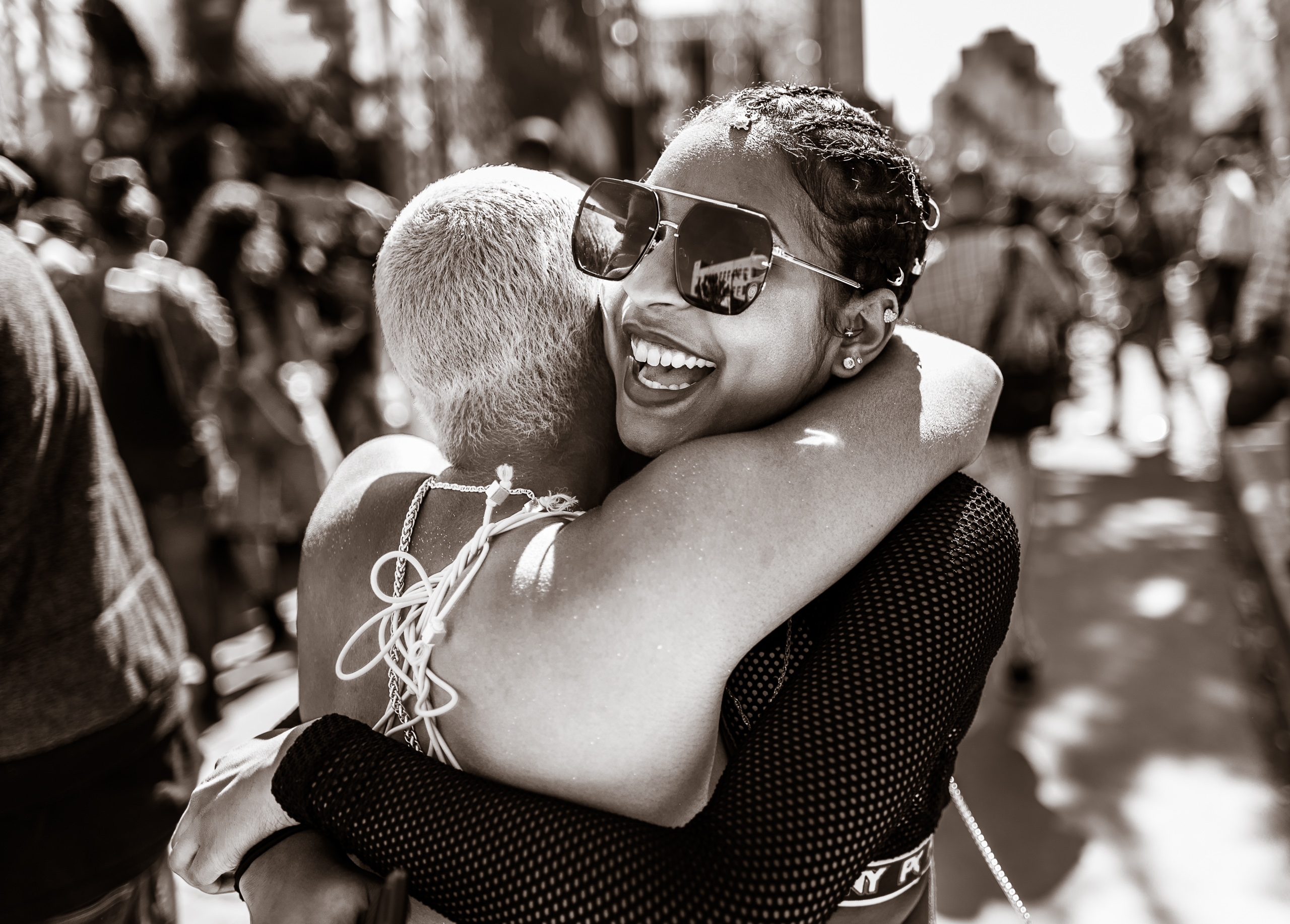two friends share a big embrace after the Hollywood Carnival Parade