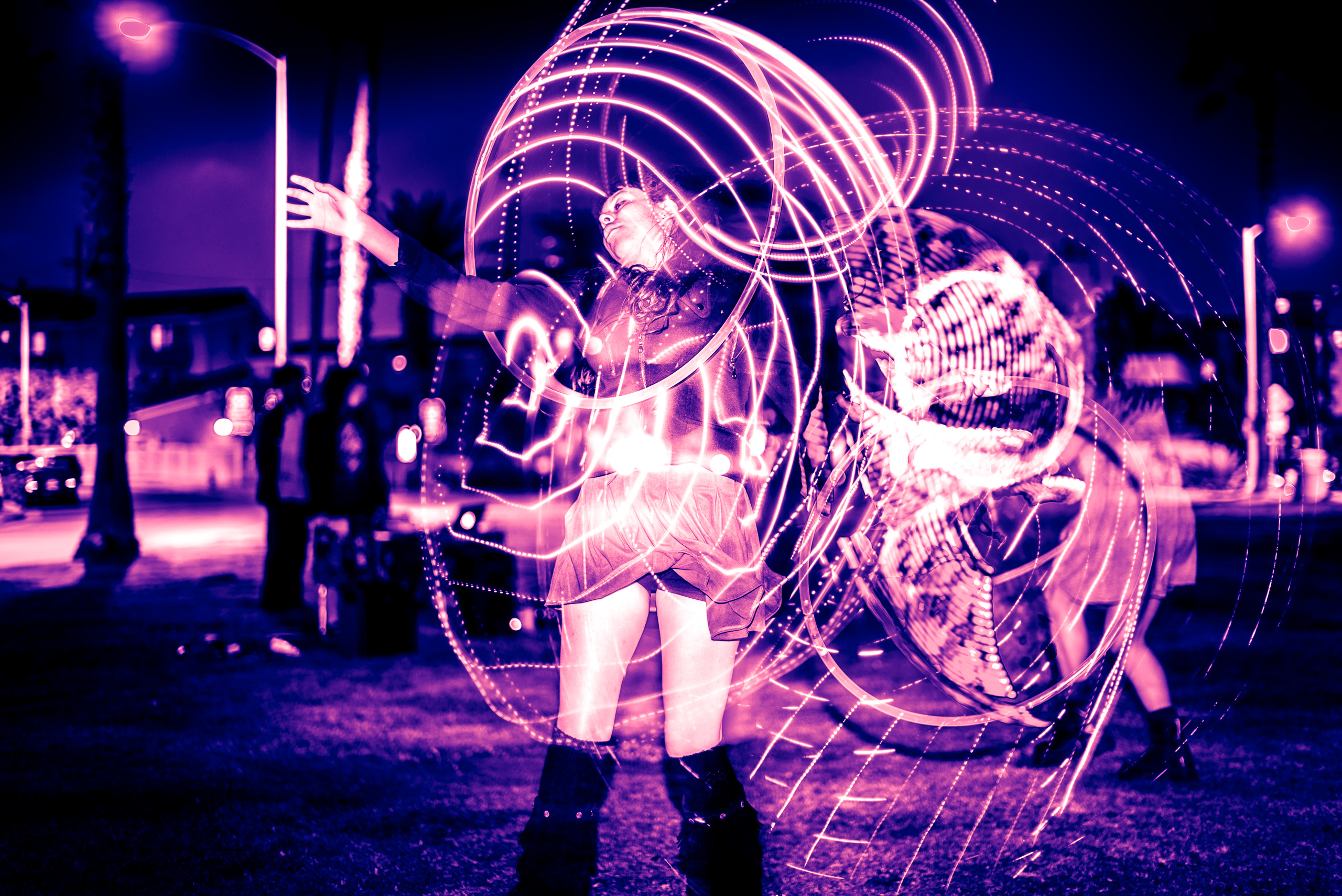 "Sabrina Rodriguez, Sabrina ""the Hoopist"" Rodaisin, performing with an LED Hula Hoop at Venice Glow Flow's Wednesday night jam/class in the park in Venice Beach, CA"