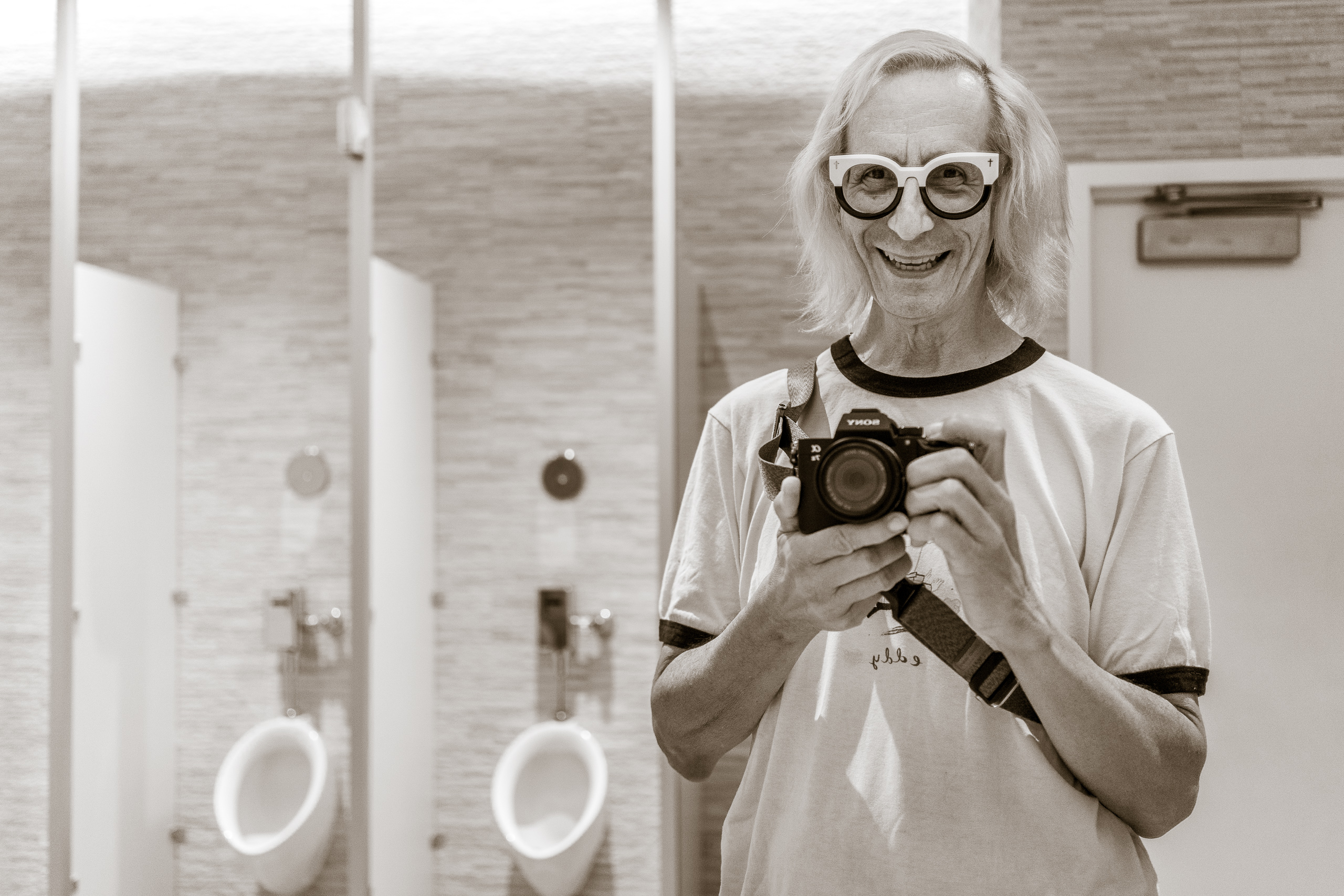 Glenn Zucman taking a selfie in the men's room mirror in the 3rd floor restrooms at the Marciano Art Foundation on Wilshire Blvd