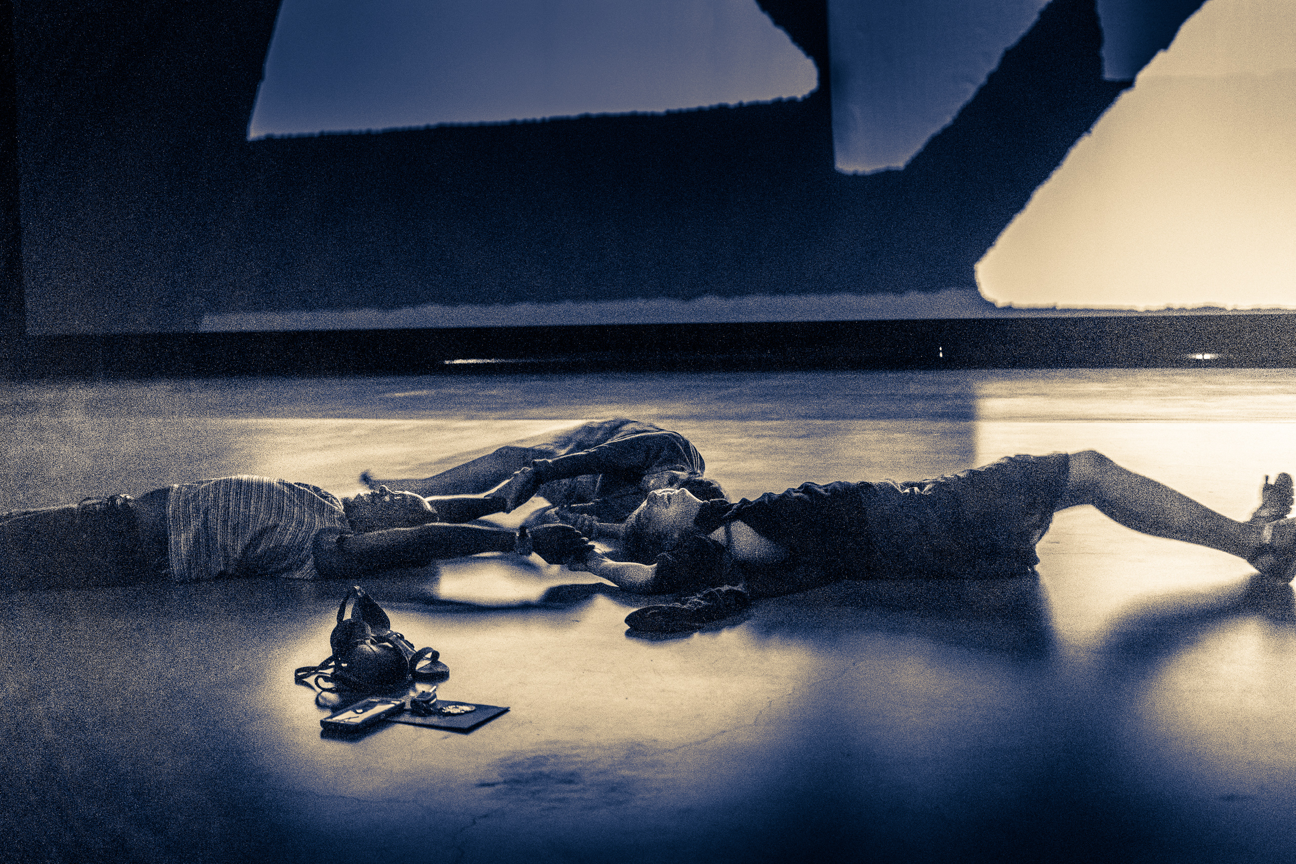 a group of 3 people doing a dance improv on the floor of the Marciano Art Foundation in response to the experience of Olafur Eliasson's Reality Projector installation