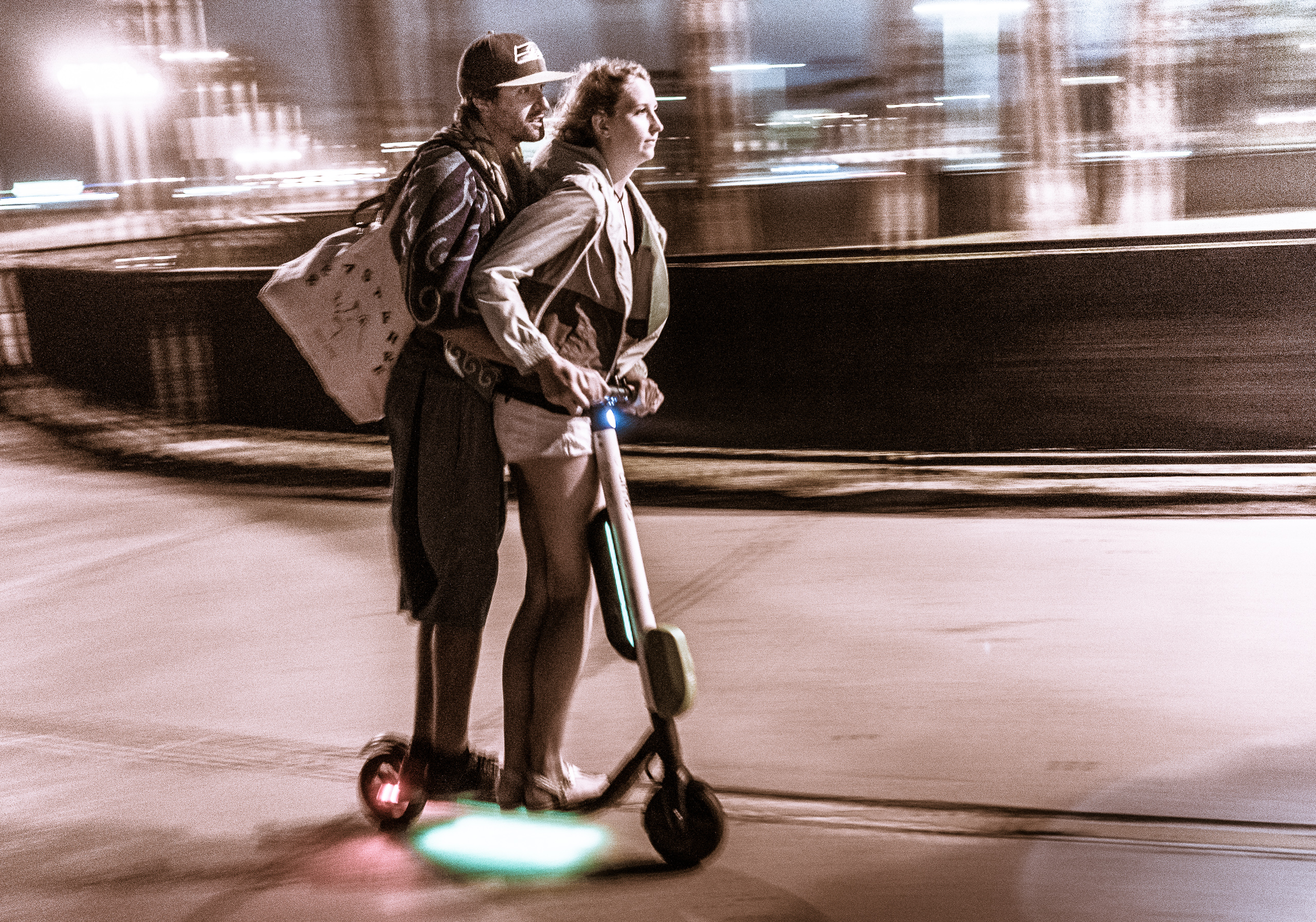 a couple riding the bike path between Venice and Santa Monica on an electric scooter