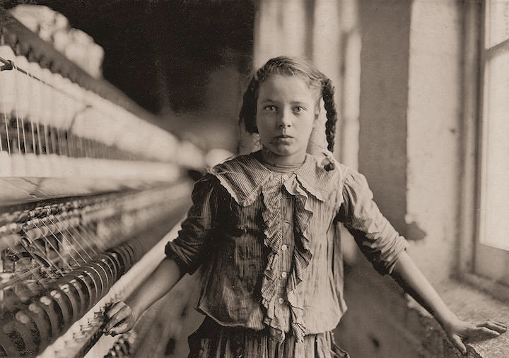 Photo of a young girl working in a mill. Lewis Hine, 1908-1912