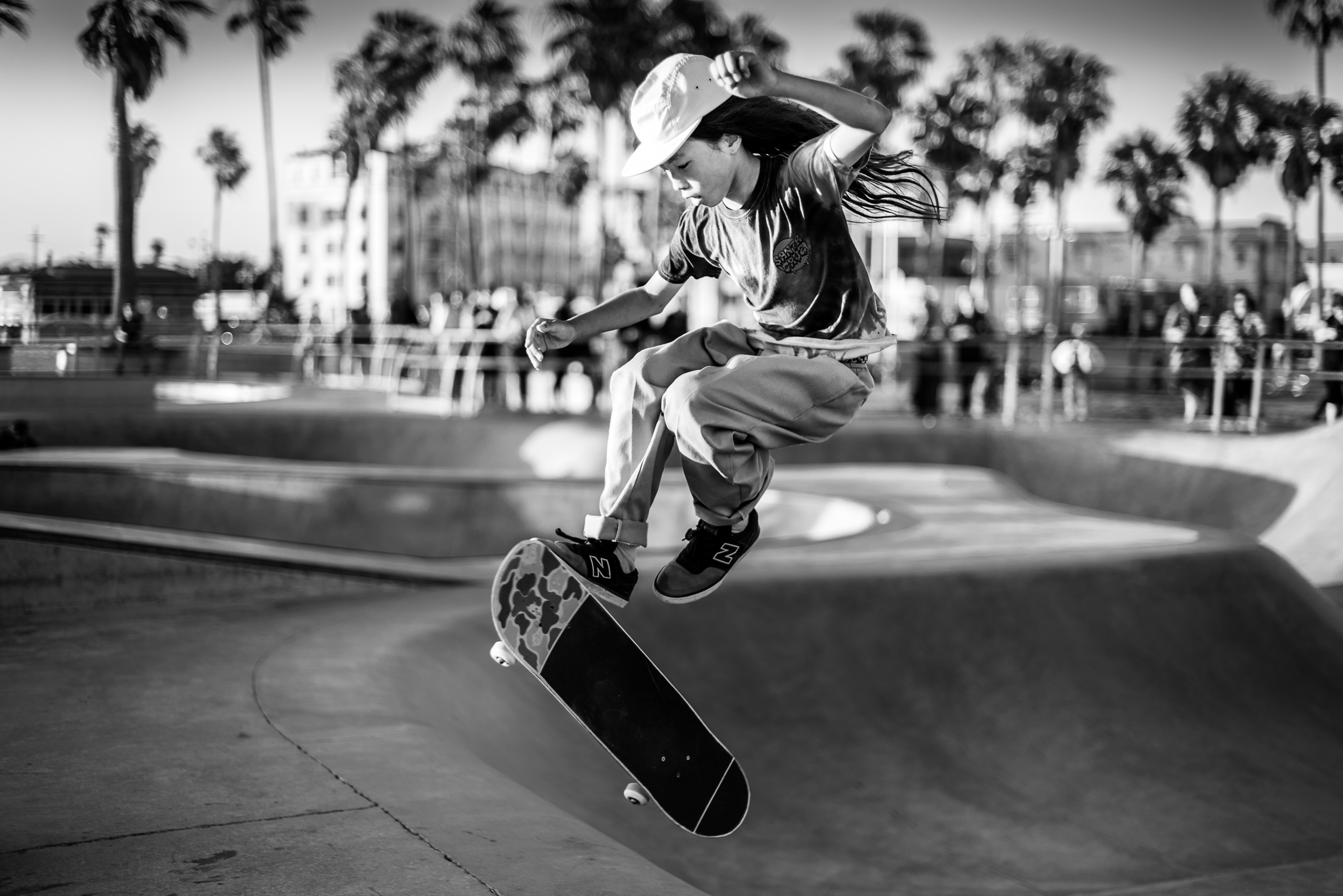 a young skateboarder catches a lot of air at the Skate Park in Venice Beach, CA