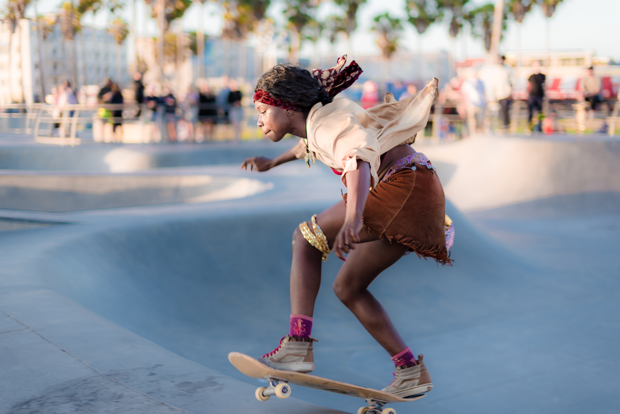 a woman skater rides through the turn at the Venice Skate Park