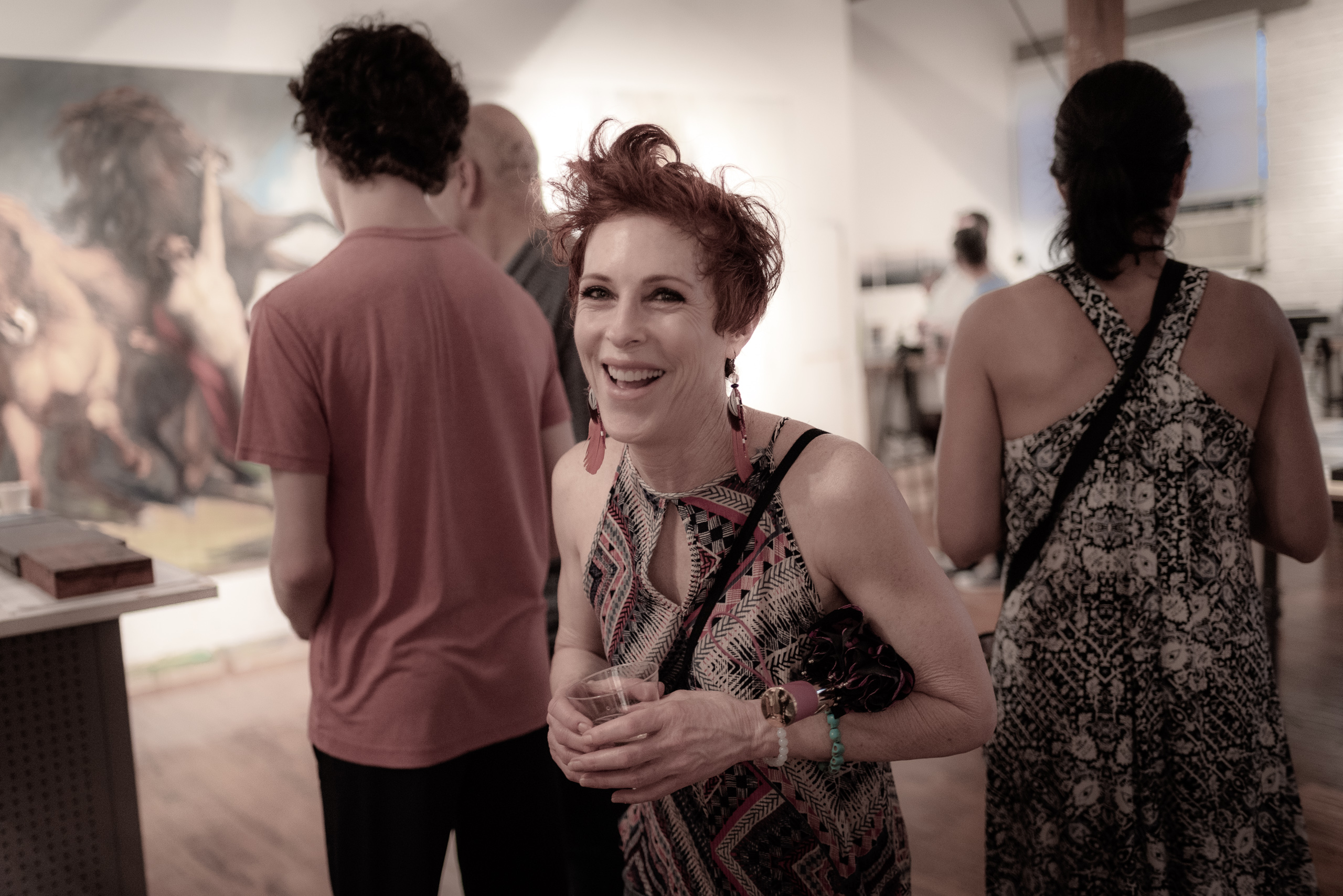 visitors to Lawrence Fodor's Open Studio enjoy the art, the drinks, and the party