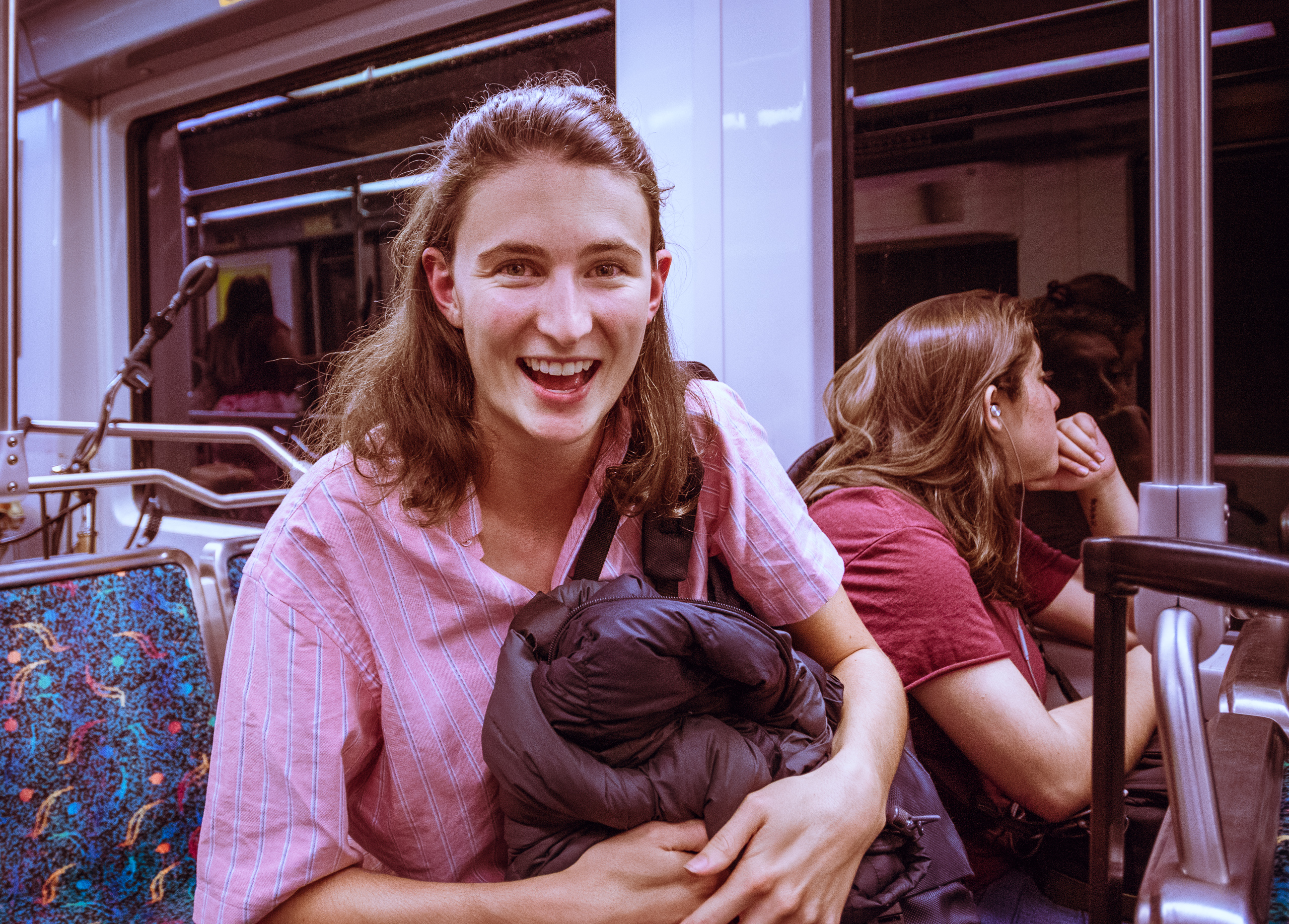 Tessa Forde smiles with her modest luggage in tow as she rides the LA Metro Gold Line home from an 8-day trip to Costa Rica