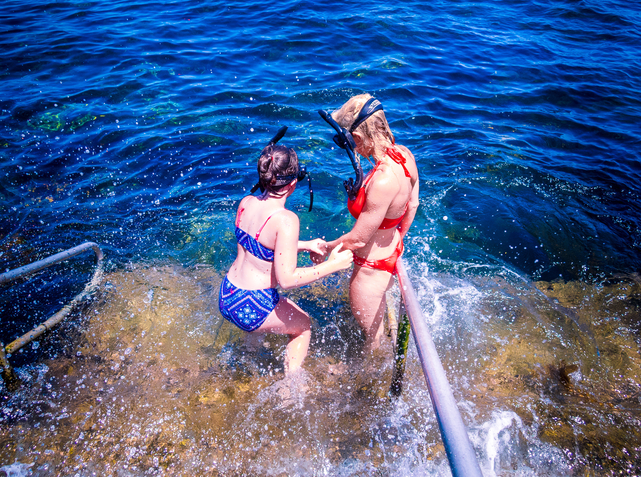 a family friend takes a young girl on her 1st snorkeling experience at the Casino Steps in Avalon, Catalina, Channel Islands, Los Angeles, California