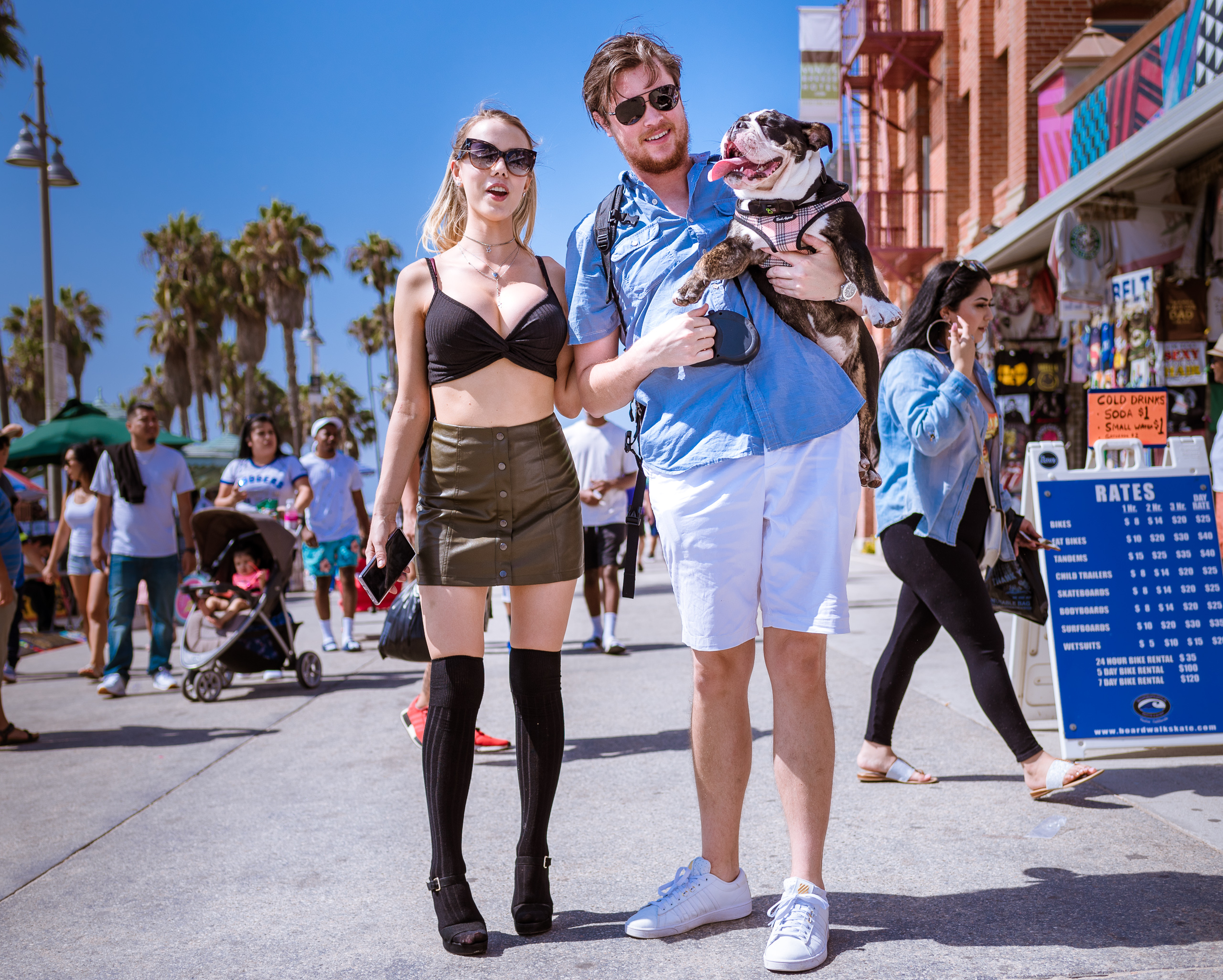 Gabby, Edward & Kona posing on the Venice Boardwalk in Venice Beach, California