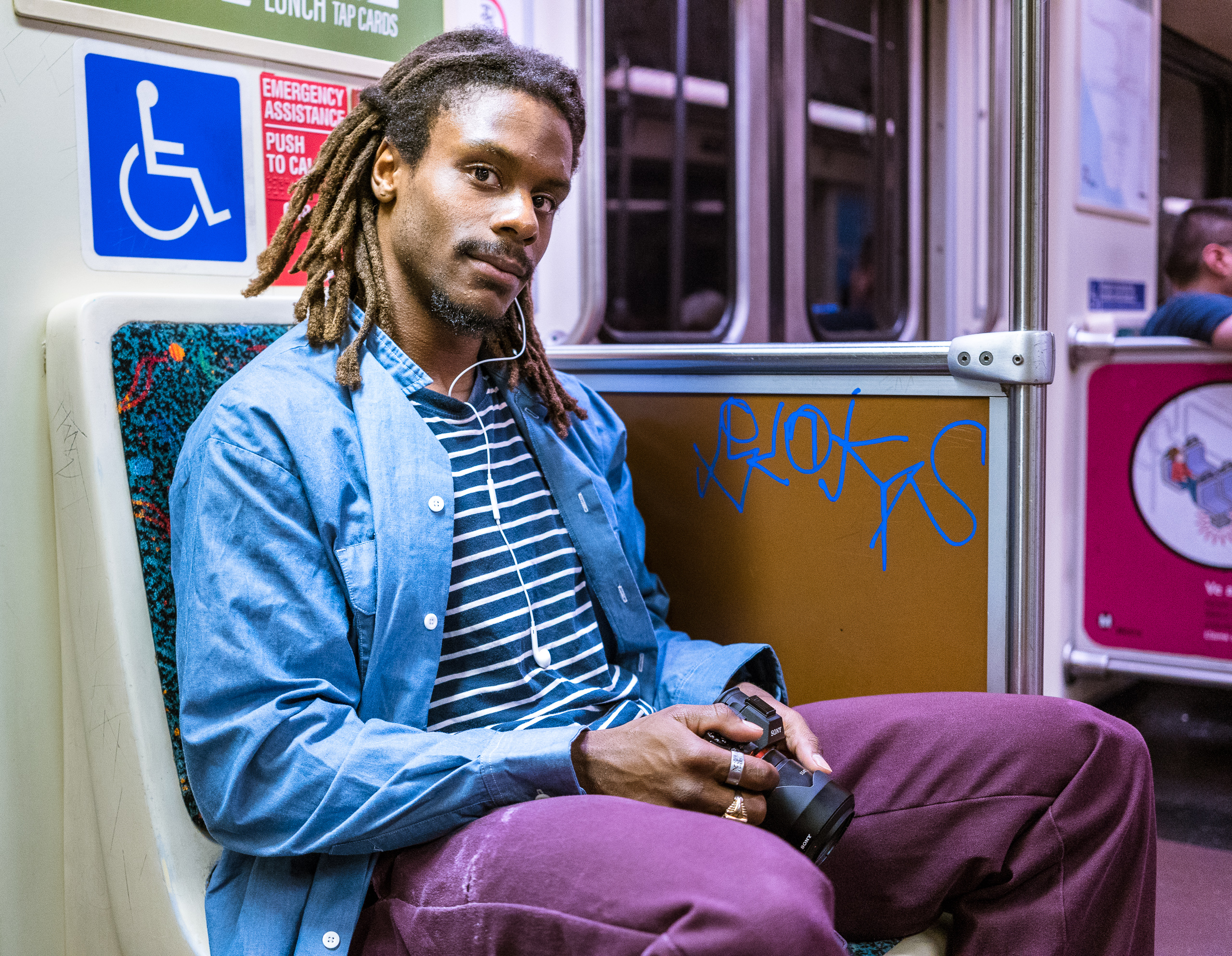 Ashanti Maurice riding the LA Metro Red Line and carrying his Sony A7R2