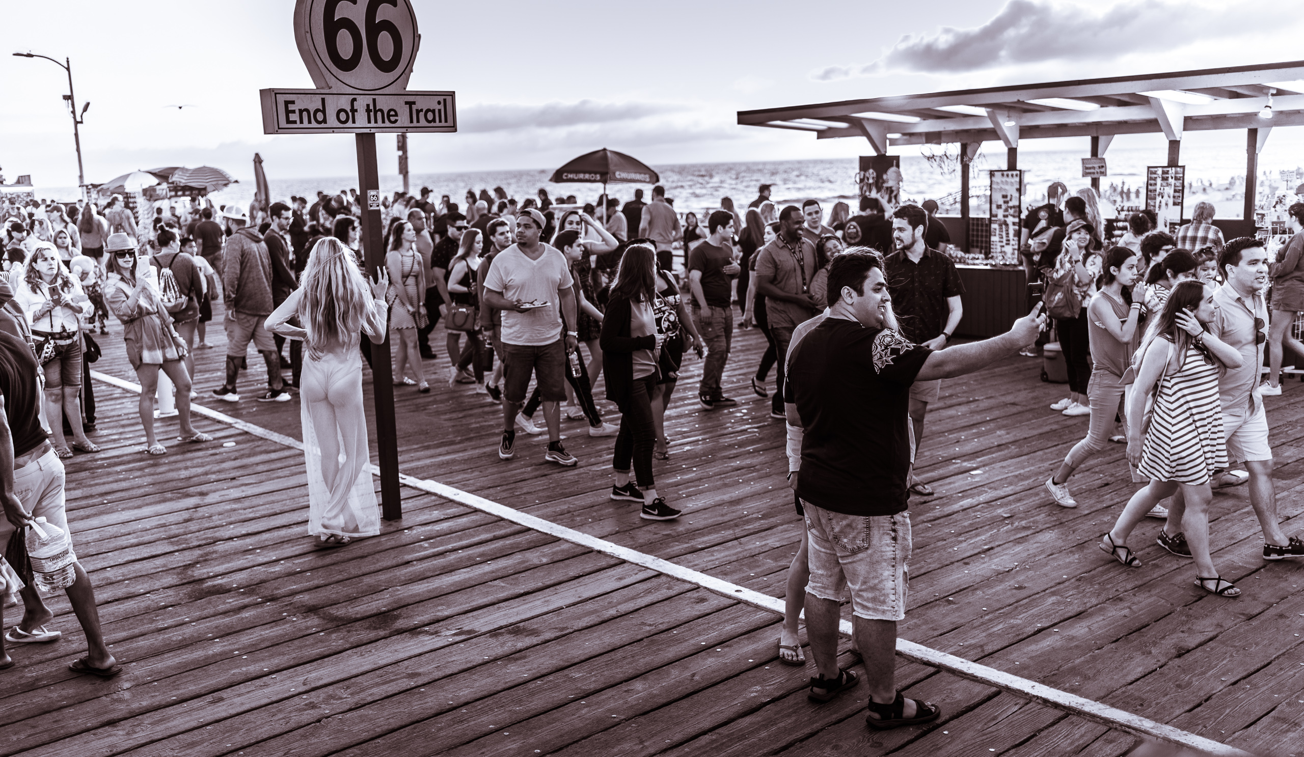 a wide, genre scene of people on the Santa Monica Pier on Labor Day
