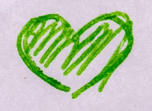 a tiny heart drawn in green ballpoint pen