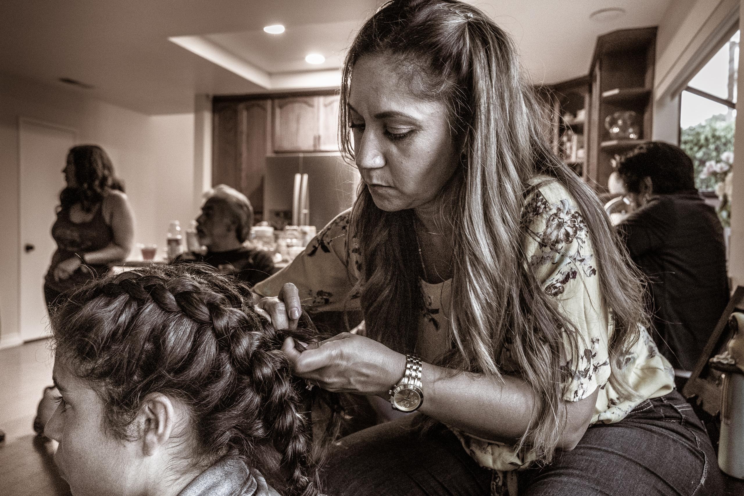 Andrea braiding Kirra's hair
