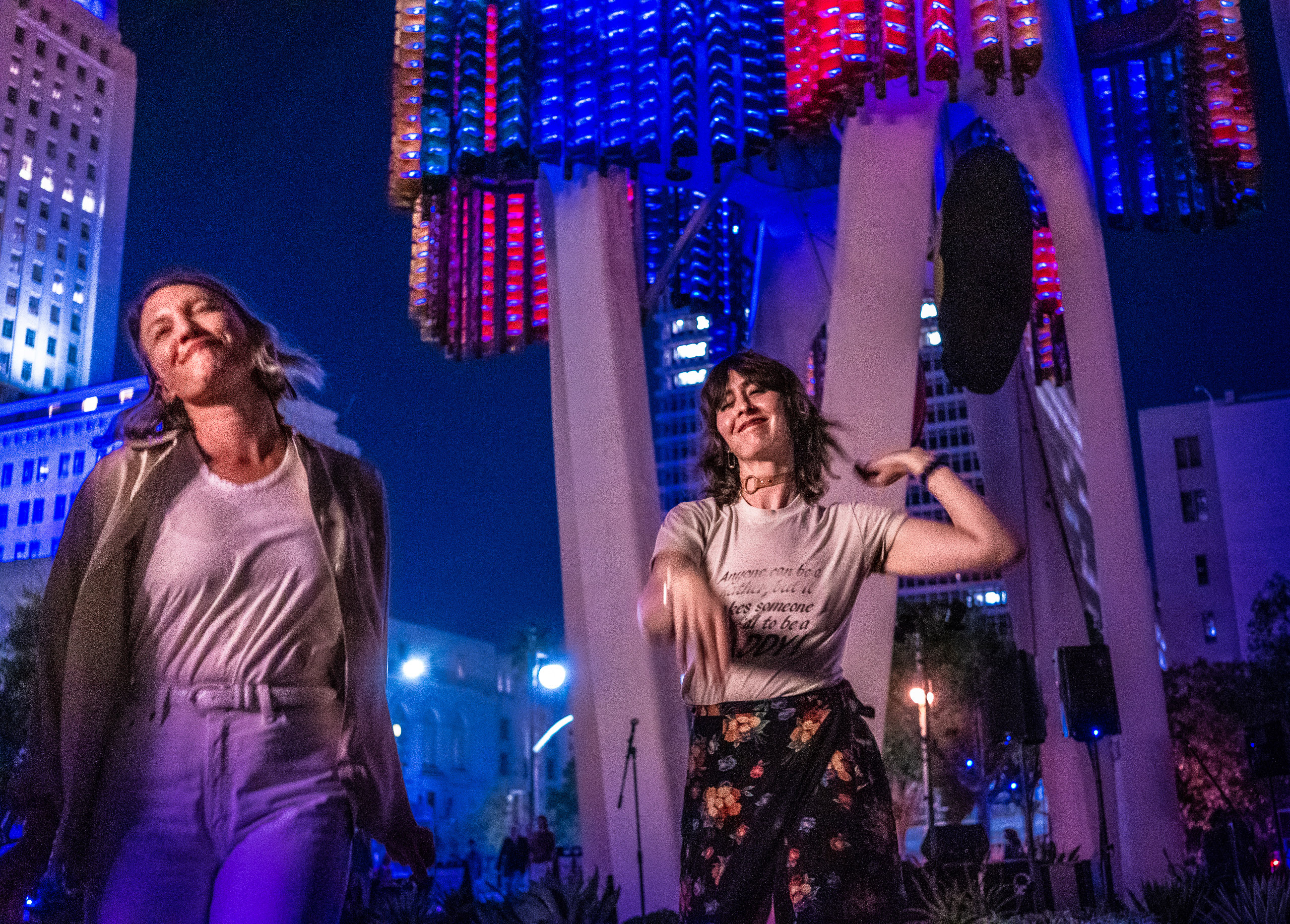 Two women dancing in front of the 2018 reanimated 1975 Triforium light and sound sculpture in Downtown Los Angeles