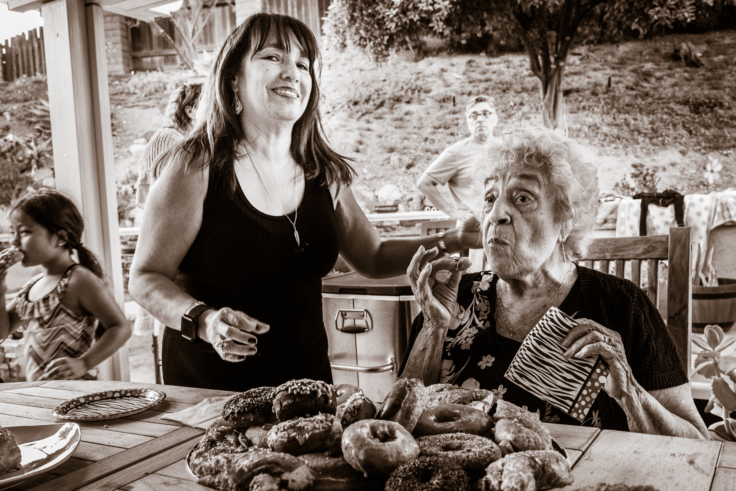 Mary Perez and her daughter Alicia Vargas having a donut at Mary's 88th birthday party in Pomona, CA