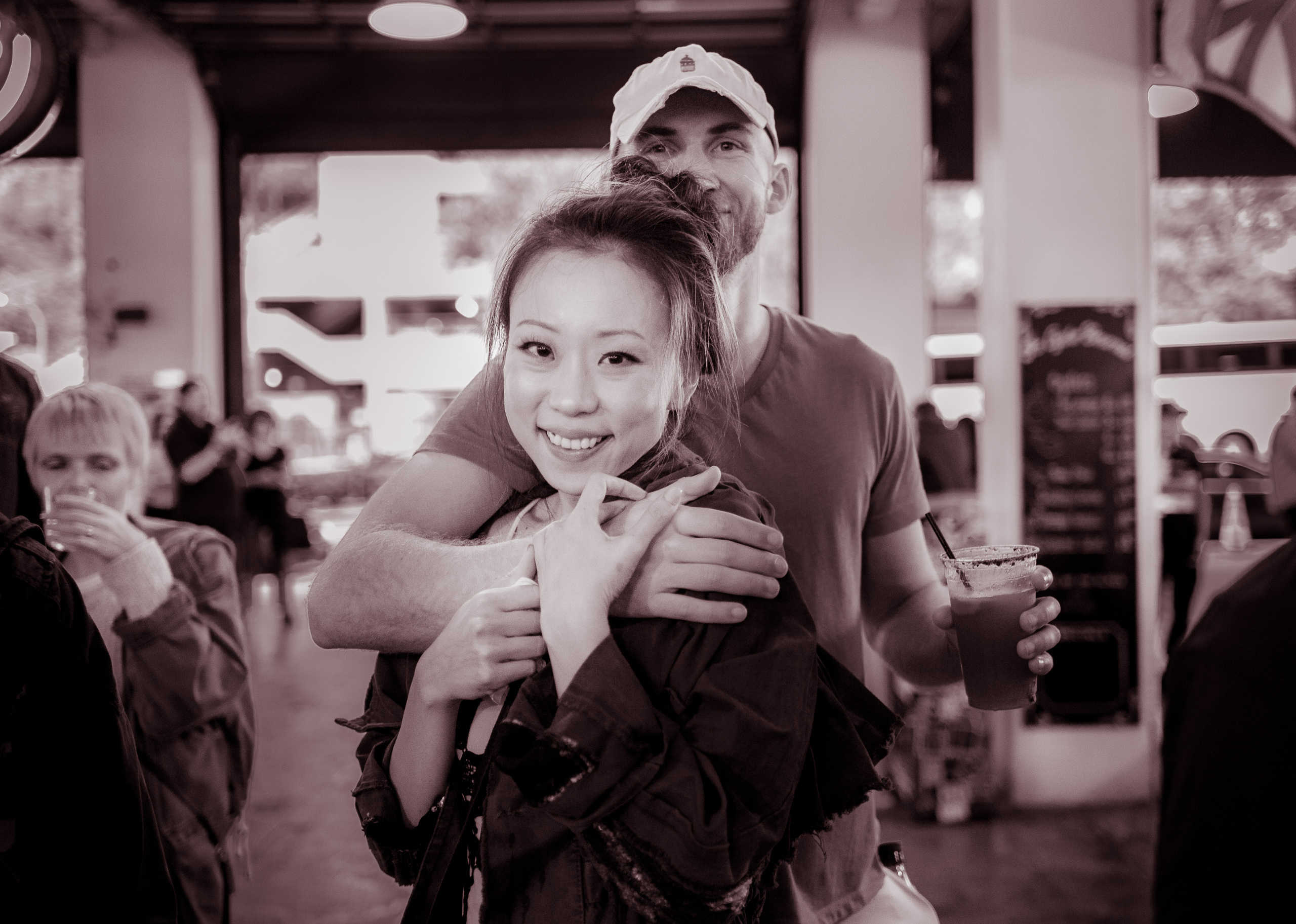 A couple embraces and sways to the music of The Mudbug Brass Band at the DTLA Oyster Festival at Grand Central Market in Downtown Los Angeles