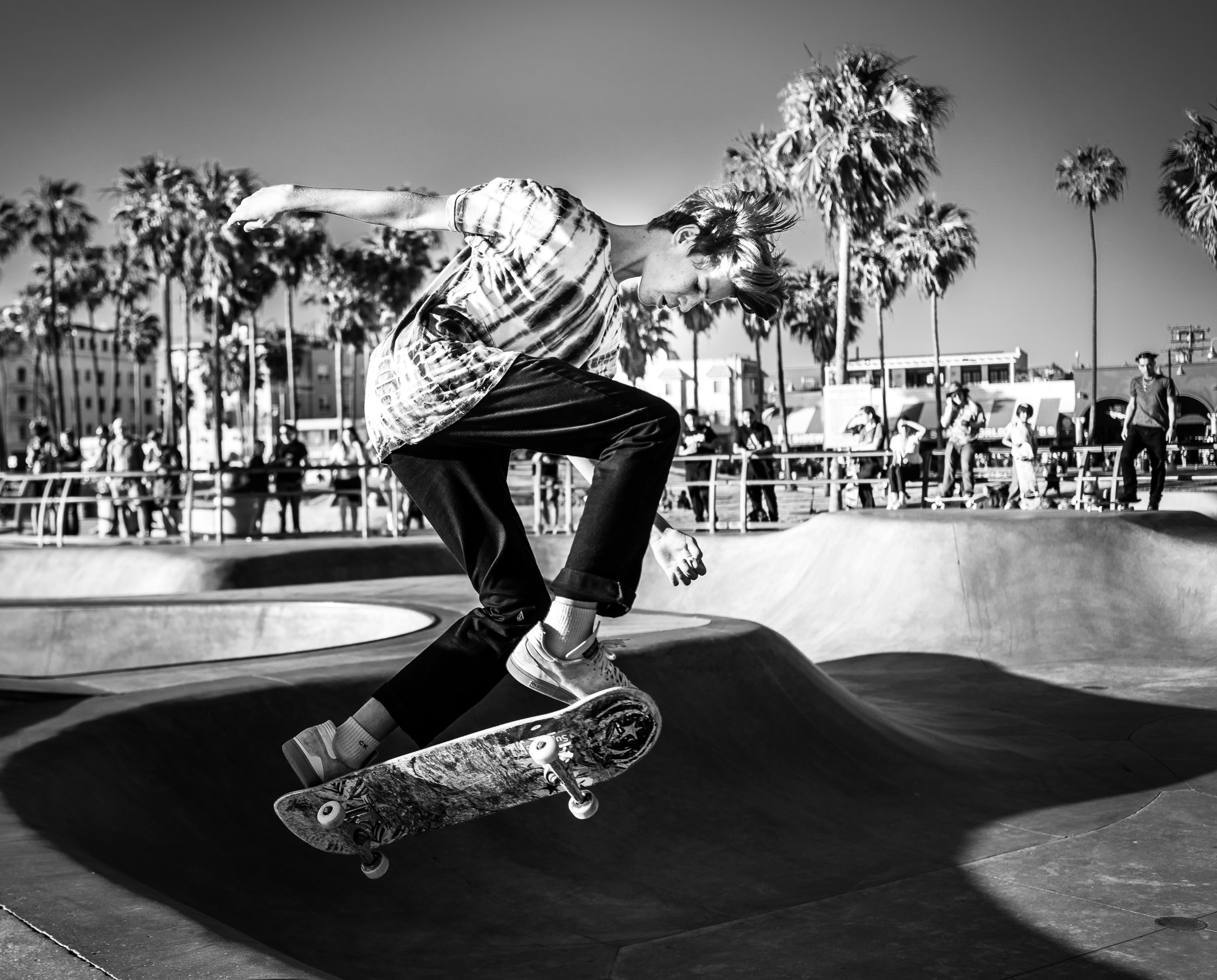 a skater flies above the rim at the Venice Skate Park in Venice Beach, California