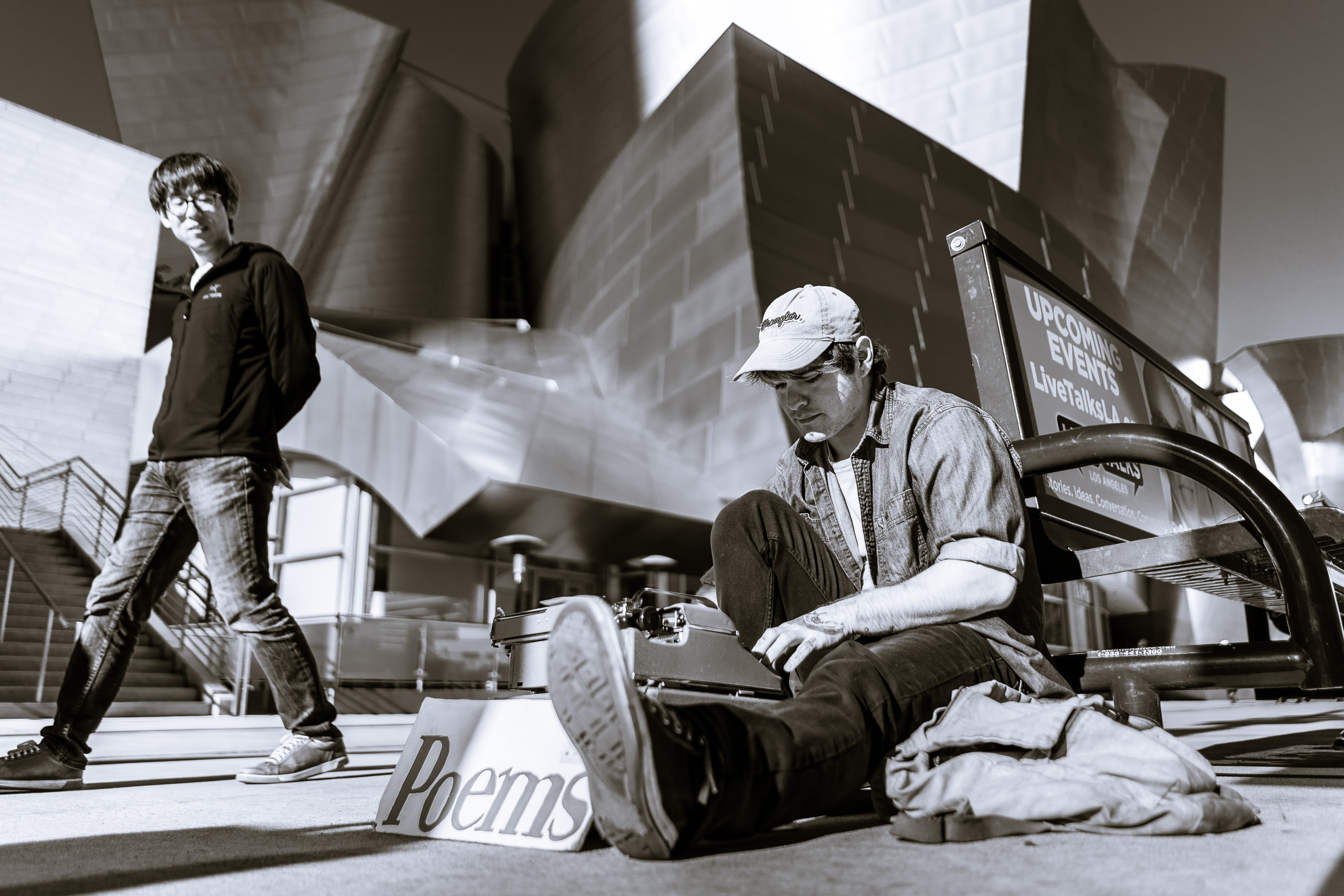 "a ""typewriter poet"" writes ""The Destiny of Los Angeles"" for me, sitting on his skateboard in front of Disney Hall on Grand Avenue in DTLA"