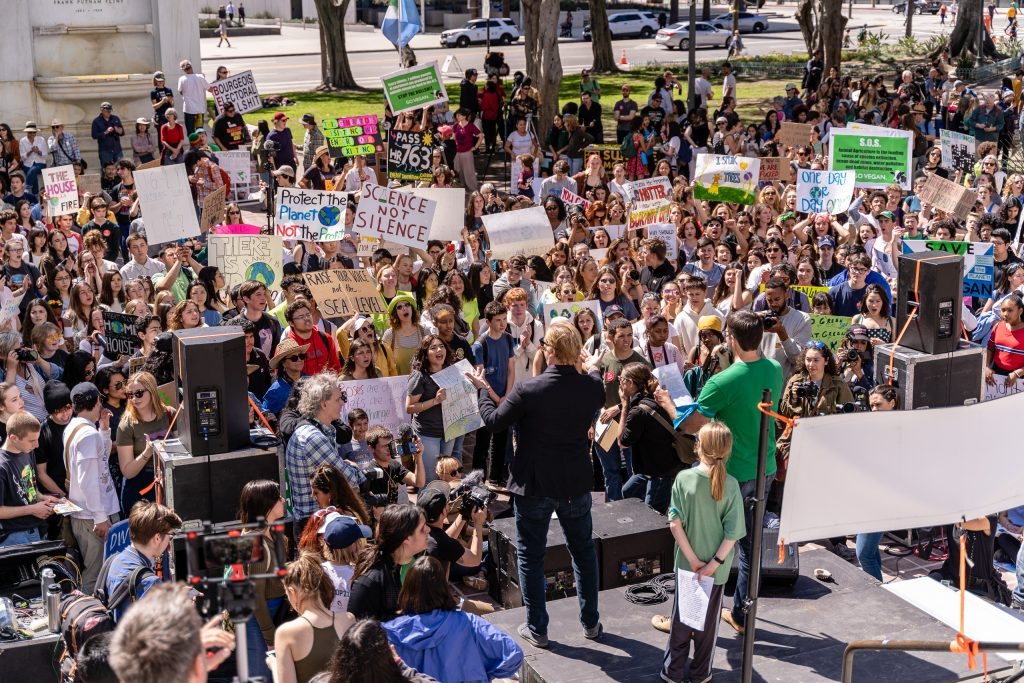 "Participants in the Los Angeles Youth Climate Strike listen to speakers at Los Angeles City Hall on Friday, Marcy 15, 2019. ""Fridays for the Future"" is organized by 16-year-old Swede Greta Thunberg. The Los Angeles Youth Climate March is organized by 17-year-old Los Angeleño Arielle Martinez-Cohen. (Glenn Zucman/The Corsair)"