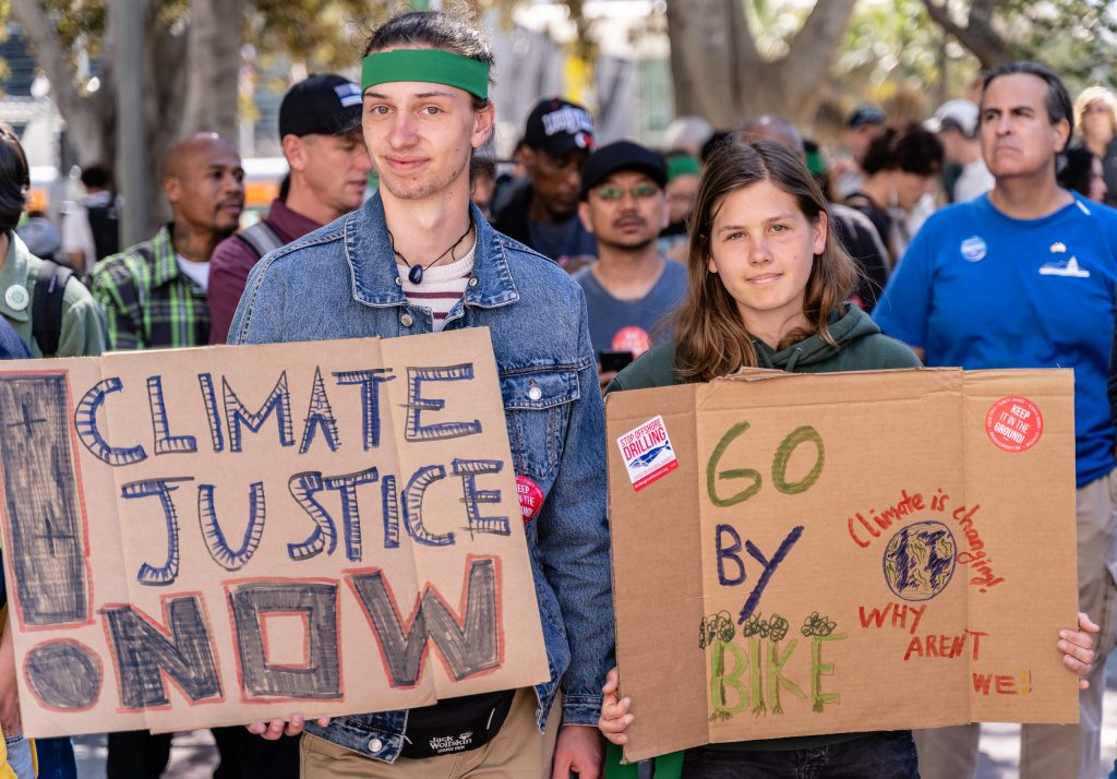 "Lennart Jensen and Emma Appelt, both 17-years-old, and both visiting Los Angeles from Marion Dönhoff Gymnasium in Hamburg in Northern Germany hold signs in front of Los Angeles City Hall on Friday, March 15, 2019. Their school is currently on break and so they are visiting Los Angeles. Back in Hamburg, they have participated in other ""Fridays for the Future"". Jensen said the Hamburg march two weeks ago had 10,000 people. He said, ""I'm here for climate justice."" Appelt said, ""We're striking also in Hamburg."" ""Fridays for the Future"" is organized by 16-year-old Swede Greta Thunberg. The Los Angeles Youth Climate March is organized by 17-year-old Los Angeleño Arielle Martinez-Cohen. (Glenn Zucman/The Corsair)"