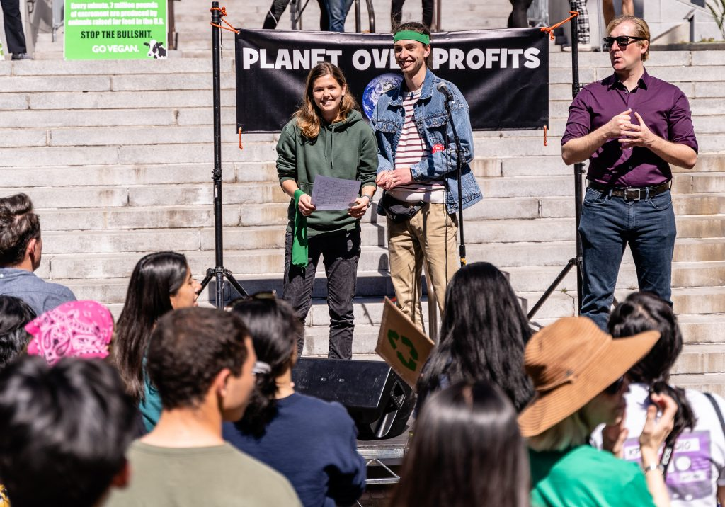 "Emma Appelt and Lennart Jensen, both 17-years-old, and both visiting Los Angeles from Marion Dönhoff Gymnasium in Hamburg in Northern Germany address the crowd in front of Los Angeles City Hall on Friday, March 15, 2019. Their school is currently on break and so they are visiting Los Angeles. Back in Hamburg, they have participated in other ""Fridays for the Future"". Jensen said the Hamburg march two weeks ago had 10,000 people. He said, ""I'm here for climate justice."" Appelt said, ""We're striking also in Hamburg."" ""Fridays for the Future"" is organized by 16-year-old Swede Greta Thunberg. The Los Angeles Youth Climate March is organized by 17-year-old Los Angeleño Arielle Martinez-Cohen. (Glenn Zucman/The Corsair)"
