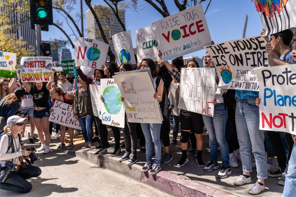 "Participants in the Los Angeles Youth Climate Strike hold signs and chant in Downtown Los Angeles on Friday, Marcy 15, 2019. ""Fridays for the Future"" is organized by 16-year-old Swede Greta Thunberg. The Los Angeles Youth Climate March is organized by 17-year-old Los Angeleño Arielle Martinez-Cohen. (Glenn Zucman/The Corsair)"