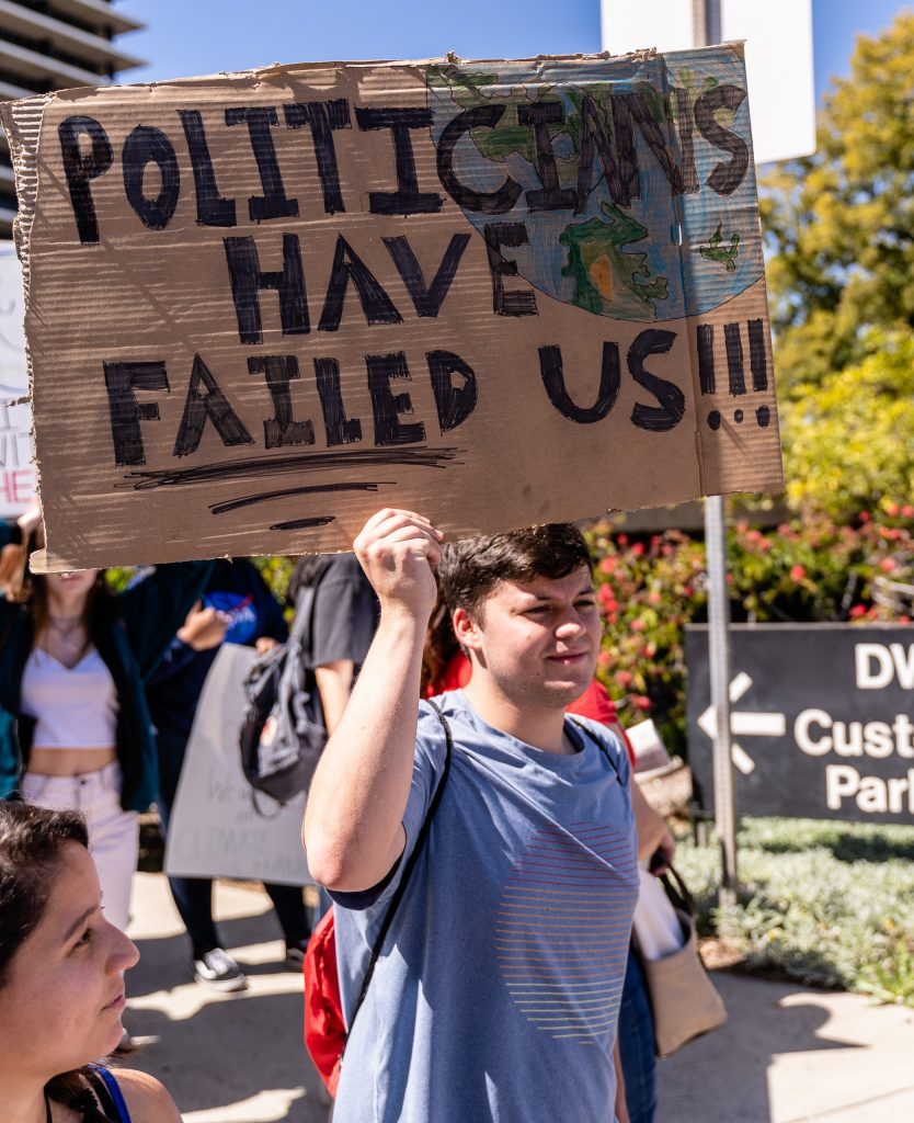 """Edgar McGregor, 18, from Pasadena City College marches in the Youth Climate Strike at Los Angeles City Hall on Friday, March 15, 2019. McGregor said he was marching because """"I have been studying climate change and the climate here today is nothing like it was 100 years ago. This can't continue, we have to stop it now."""" """"Fridays for the Future"""" is organized by 16-year-old Swede Greta Thunberg. The Los Angeles Youth Climate March is organized by 17-year-old Los Angeleño Arielle Martinez-Cohen. (Glenn Zucman/The Corsair)"""