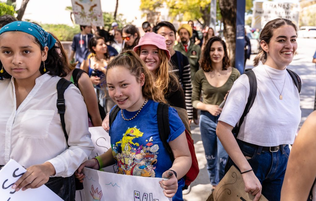 "Participants in the Los Angeles Youth Climate Strike march through Downtown Los Angeles on Friday, Marcy 15, 2019. ""Fridays for the Future"" is organized by 16-year-old Swede Greta Thunberg. The Los Angeles Youth Climate March is organized by 17-year-old Los Angeleño Arielle Martinez-Cohen. (Glenn Zucman/The Corsair)"