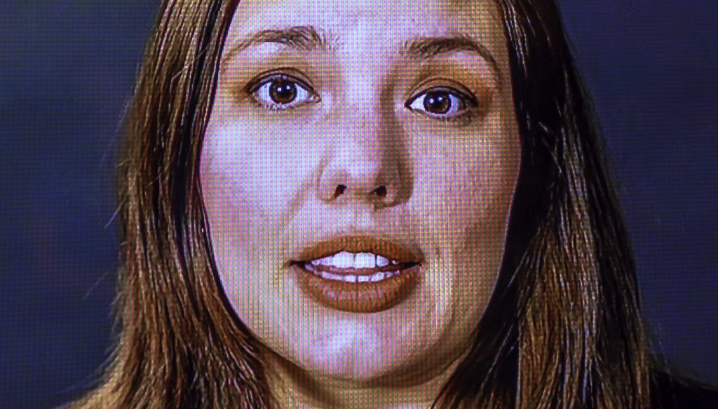 close-up of Cintia Segovia's face on a video monitor. The image is close enough that you can see the video pixels that compose her face.