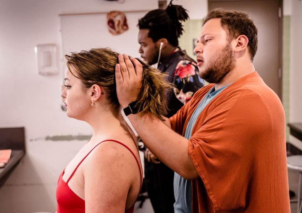 Makeup And Hair Designer Alejandro Bermudez (Right) Works With Briana Ritter's Hair Before The Tech Rehearsal For Flamenco Macbeth In The SMC Theatre Arts Dressing Rooms On Tuesday, April 23, 2019. Flamenco Macbeth Is An Adaptation From Shakespeare By SMC Theatre Arts Department Chair Perviz Sawoski. Performances Are In The SMC Studio Stage On April 26, 27, 28, And May 3, 4, 5. (Glenn Zucman/The Corsair)