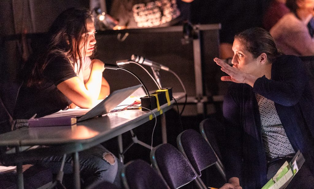 Director And SMC Theatre Arts Department Chair Perviz Sawoski (Right) Gives A Note To Stage Manager Regina Shabanova During The Tech Rehearsal For Flamenco Macbeth On The SMC Studio Stage On Tuesday, April 23, 2019. Flamenco Macbeth Is An Adaptation From Shakespeare By Sawoski. Performances Are In The SMC Studio Stage On April 26, 27, 28, And May 3, 4, 5. (Glenn Zucman/The Corsair)