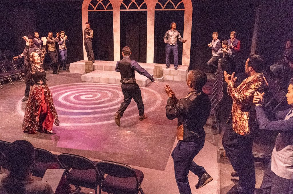 Mehmet Bakir (King Duncan) (In Gold Jacket In Lower-Right) Presides Over Festivities During A Rehearsal For Flamenco Macbeth On The SMC Studio Stage On Thursday, April 25, 2019. Flamenco Macbeth Is An Adaptation From Shakespeare By SMC Theatre Arts Department Chair Perviz Sawoski. Performances Are In The SMC Studio Stage On April 26, 27, 28, And May 3, 4, 5. (Glenn Zucman/The Corsair)