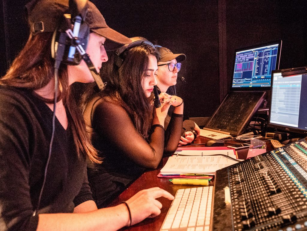 Rebecca Simon (Sound/Projection Operator), Regina Shabanova (Stage Manager), And Natalie Mancu (Light Board Operator) Run Through Cues During The Dress Rehearsal For Flamenco Macbeth On The SMC Studio Stage On Thursday, April 25, 2019. Flamenco Macbeth Is An Adaptation From Shakespeare By SMC Theatre Arts Department Chair Perviz Sawoski. Performances Are In The SMC Studio Stage On April 26, 27, 28, And May 3, 4, 5. (Glenn Zucman/The Corsair)