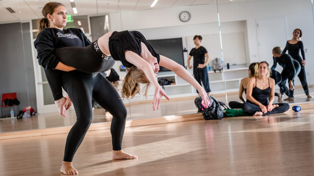 SMC Student Choreographer Julisa Figueroa (Sitting On The Floor, At Right) Watches As Noemi Nuernberger And Brittany Ganiere Rehearse A Section Of Her Work For Synapse Dance Theater In SMC's Core Performance Center On Thursday, April 25, 2019. Synapse Dance Theater Will Be Performed On The Broad Stage At SMC's Performing Arts Center On Friday And Saturday, May 24 And 25. (Glenn Zucman/The Corsair)