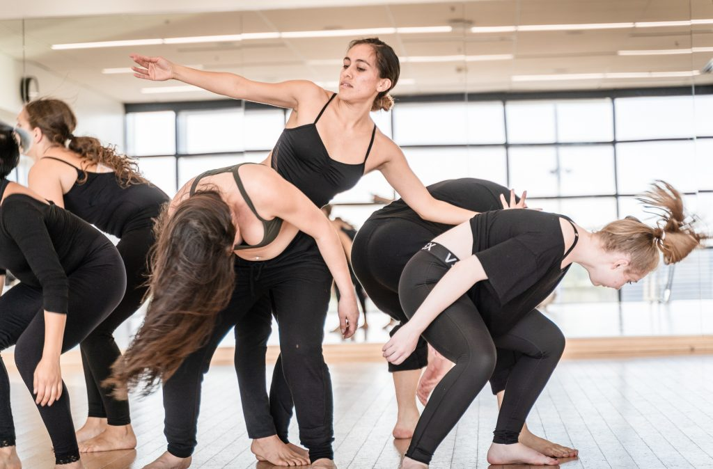 SMC Student Choreographer Julisa Figueroa (Standing, Center) Rehearses Her New Work For Synapse Dance Theater With SMC Dancers In SMC's Core Performance Center On Thursday, April 25, 2019. Synapse Dance Theater Will Be Performed On The Broad Stage At SMC's Performing Arts Center On Friday And Saturday, May 24 And 25. (Glenn Zucman/The Corsair)