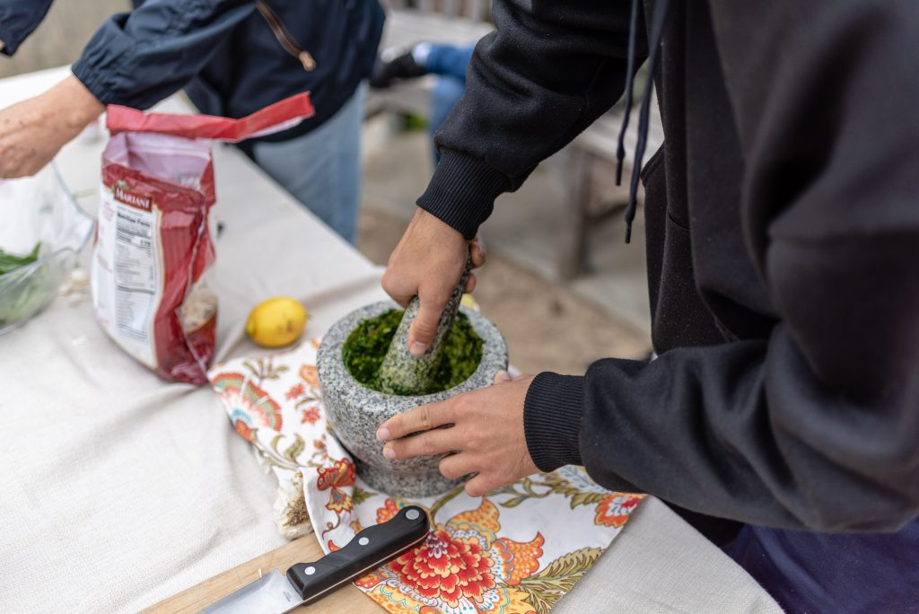 Anthropology Major Alex Sonnenschein, 29, Of Montrose, Calif., Grinds Fava Pesto In A Mortar And Pestle At Club Grow In The SMC Organic Learning Garden On Tuesday, March 5, 2019. Sonnenschein Says He Finds The Organic Learning Garden A Relief From The Stress Of His Academic Studies. (Glenn Zucman/The Corsair)
