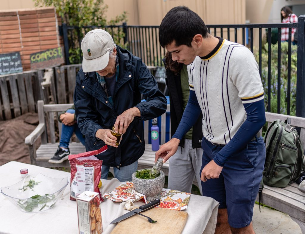 SMC Organic Learning Garden Leader Dana Morgan, A Master Gardener From University Of California Cooperative Extension, (UCCE) And A Retired SMC English Professor, And Nick Glover, A 25-Year-Old English Major From Houston, Texas, Work On Fava Pesto At The Weekly Club Grow Meeting In The Organic Learning Garden On SMC Main Campus On Tuesday, March 5, 2019. (Glenn Zucman/The Corsair)