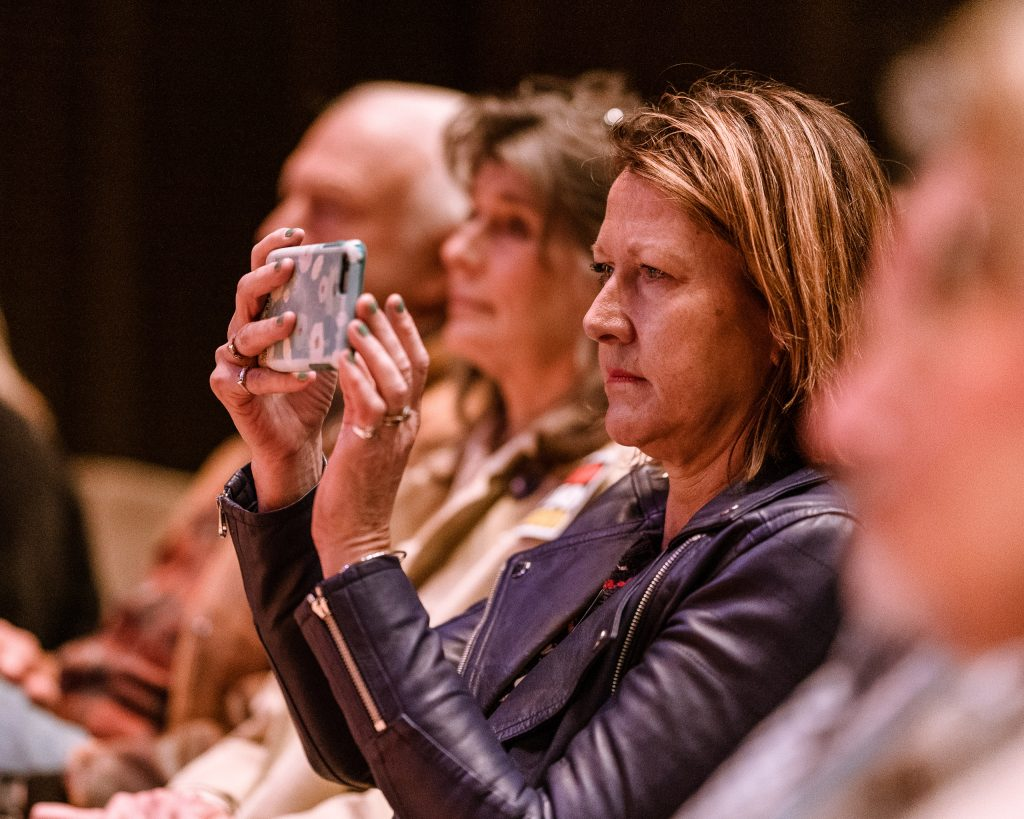 "Lesley O'Toole From Hollywood, By Way Of Hampshire, England, Sits In The Front Row And Documents The Discussion On The California Housing Crisis At The SMC Broad Stage On Thursday, May 9, 2019. O'Toole Said She Was Attending Tonight Because, ""I Want To Try To Save My Neighborhood From Destruction."" The SMC Public Policy Institute Is Presenting Its 8th Annual Spring Symposium, ""There Goes The Neighborhood, Part II: How Might Policy Approaches Prevent Displacement In Neighborhoods Affected By Gentrification?"" From May 4-9. Tonight's Final Event In The Series Is ""Where Goes The Road To Solving California's Housing Crisis? A Keynote Discussion With Legislative Leaders."" The Panel Includes California State Legislators Senator Ben Allen (SD26 – Santa Monica) And Senator Scott Weiner (SD11 – San Francisco), Author Of SB 50 Which Proposes Bold Approaches To California's Housing Issues, And Santa Monica Mayor Gleam Davis, A Former Co-Chair Of Santa Monicans For Renters' Rights And Leading Advocate For Santa Monica's Innovative Policy Solutions And Funding For Affordable Housing."" (Glenn Zucman/The Corsair)"