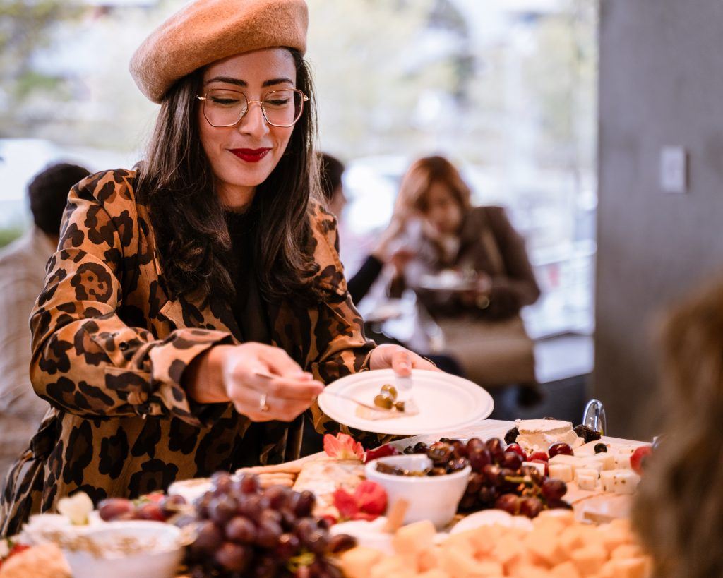 "SMC Fashion Design Major Yasmina Sadki From Reims, France Serves Herself Some Olives From The Hors D'oeuvres Table At The Reception Before Tonight's Housing Discussion At The SMC Broad Stage On Thursday, May 9, 2019. Sadki Said That She Came Partly For The Extra Credit Offered By Her SMC Political Science Instructor, But That She Is ""Also Very Interested In The Issues. I Hope To Be An Investor In Real Estate One Day, So I Want To Understand Both Sides. Also, I Love Cheese!"" The SMC Public Policy Institute Is Presenting Its 8th Annual Spring Symposium, ""There Goes The Neighborhood, Part II: How Might Policy Approaches Prevent Displacement In Neighborhoods Affected By Gentrification?"" From May 4-9. Tonight's Final Event In The Series Is ""Where Goes The Road To Solving California's Housing Crisis? A Keynote Discussion With Legislative Leaders."" The Panel Includes California State Legislators Senator Ben Allen (SD26 – Santa Monica) And Senator Scott Weiner (SD11 – San Francisco), Author Of SB 50 Which Proposes Bold Approaches To California's Housing Issues, And Santa Monica Mayor Gleam Davis, A Former Co-Chair Of Santa Monicans For Renters' Rights And Leading Advocate For Santa Monica's Innovative Policy Solutions And Funding For Affordable Housing."" (Glenn Zucman/The Corsair)"