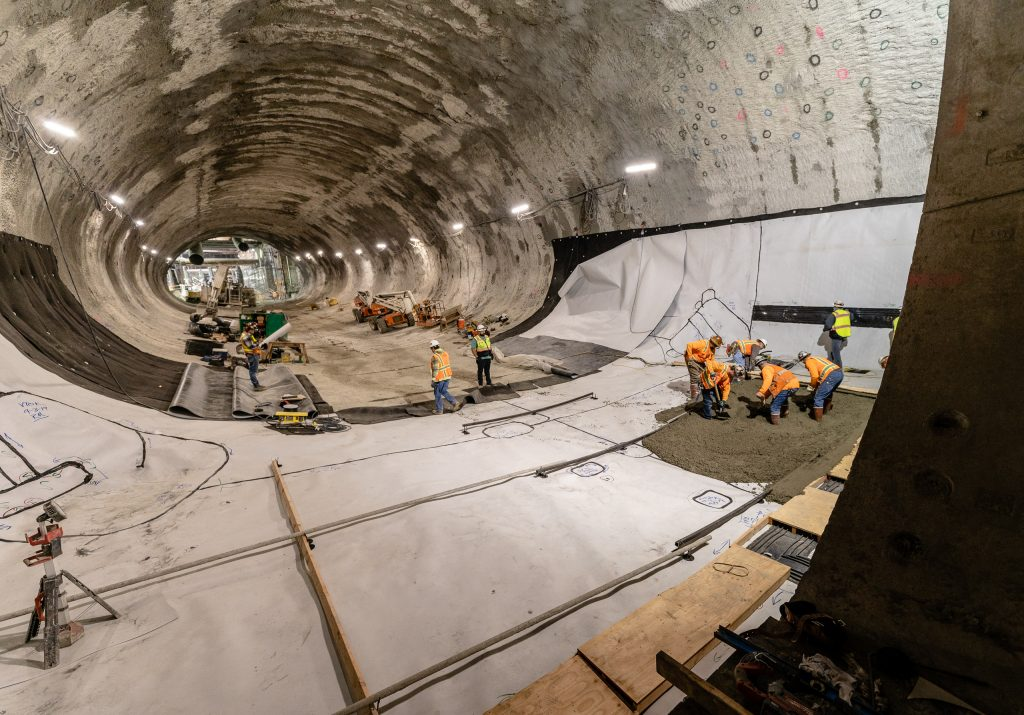At The End Of The Two Metro Regional Connector Tunnels That Run Underneath 2nd Street In Downtown Los Angeles Is A Construction Site Where Crews Build A Crossover Area Where Trains Will Be Able To Switch Tracks On Wednesday, April 3, 2019. The Oval-Shaped Space In The Upper-Center Of The Image Is The Future Historic Broadway Station At 2nd Street And Broadway. Because Construction From Above Was Not Possible, Crews Had To Excavate This Crossover Cavern From The Tunnels The Trains Will Run In When The Project Completes In 2022. (Glenn Zucman/The Corsair)