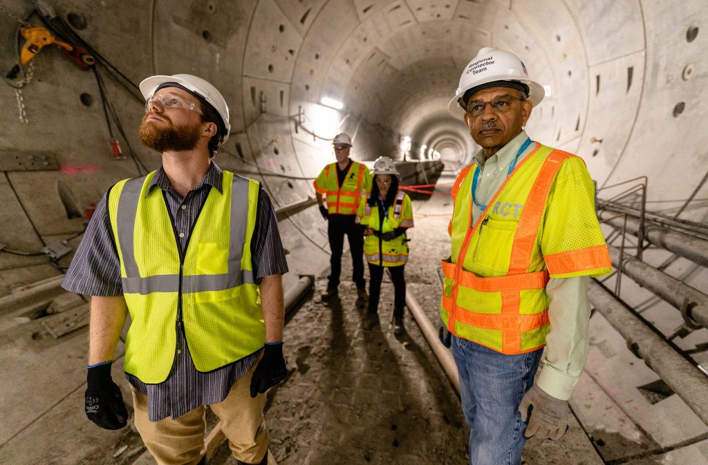 Corsair Staff Writer Michael Fanelli And Metro Regional Connector Director Of Construction Management Rajni Patel Walk Through A Metro Rail Tunnel Beneath 2nd Street In Downtown Los Angeles On Wednesday, April 2, 2019. When Completed In 2022 The Regional Connector Will Add New Stations At Little Tokyo/Arts District, Historic Broadway, And Grand Avenue Arts/Bunker Hill. The Regional Connector Will Simplify East-West And North-South Travel In Los Angeles. A Trip From East Los Angeles College To Santa Monica College Which Currently Requires 2 Transfers And 3 Trains, Will Require Only One Train When This New Segment Opens In 2022. (Glenn Zucman/The Corsair)