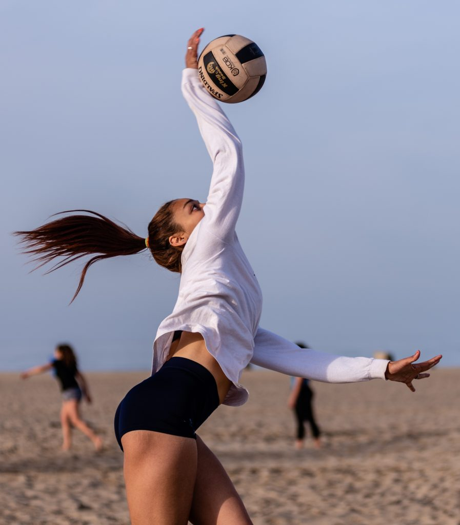 "Angelina Burton, A 5'10"" Freshman From Palisades High Jumps To Drive The Ball Across The Net At Corsair Beach Volleyball Practice At Santa Monica Beach On Tuesday Morning March 26, 2019. The SMC Corsairs Beach Volleyball Season Began In February And Runs Through April 2019. (Glenn Zucman/The Corsair)"
