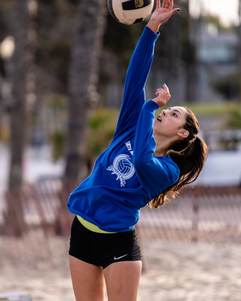 "Elena Eckardt, A 5'10"" Freshman From Palm Springs High, Jumps To Drive The Ball Across The Net At SMC Beach Volleyball Practice At Santa Monica Beach On Tuesday, March 26, 2019. The Beach Volleyball Season Began In February And Runs Through April 2019. (Glenn Zucman/The Corsair)"