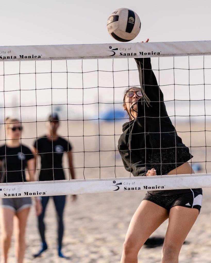 "Maria Larranaga, A 5'9"" Freshman From Knight High, Powers The Ball Across The Net At SMC Beach Volleyball Practice At Santa Monica Beach On Tuesday, March 26, 2019. The Beach Volleyball Season Began In February And Runs Through April 2019. (Glenn Zucman/The Corsair)"