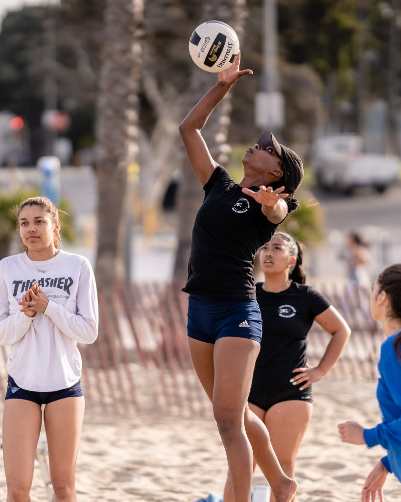 "Brianna Montgomery, A 5'10"" Freshman From Louisville High, Spikes The Ball Across The Net At SMC Beach Volleyball Practice At Santa Monica Beach On Tuesday, March 26, 2019. The Beach Volleyball Season Began In February And Runs Through April 2019. (Glenn Zucman/The Corsair)"