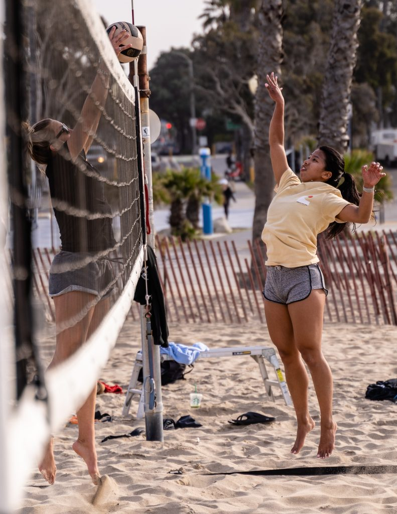 "Brooke Michaels, A 5'10"" Freshman From Campbell Hall High, Blocks A Shot By Assistant Coach Bea Hernandez At SMC Beach Volleyball Practice At Santa Monica Beach On Tuesday, March 26, 2019. The Beach Volleyball Season Began In February And Runs Through April 2019. (Glenn Zucman/The Corsair)"