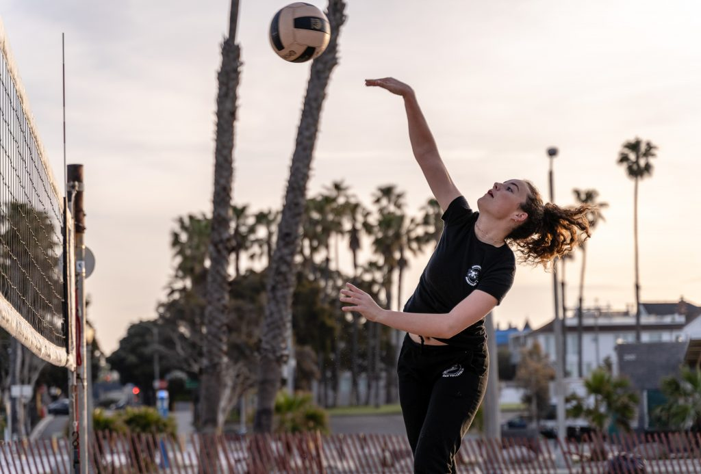 "Camilla Wilson, A 5'6"" Freshman From New Roads High, Drives The Ball Across The Net At SMC Beach Volleyball Practice At Santa Monica Beach On Tuesday, March 26, 2019. The SMC Corsairs Beach Volleyball Season Began In February And Runs Through April 2019. (Glenn Zucman/The Corsair)"