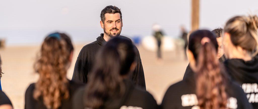 Head Coach Dan Freeman Talks With The Team Before SMC Beach Volleyball Practice At Santa Monica Beach On Tuesday, March 26, 2019. The SMC Corsairs Beach Volleyball Season Began In February And Runs Through April 2019. (Glenn Zucman/The Corsair)