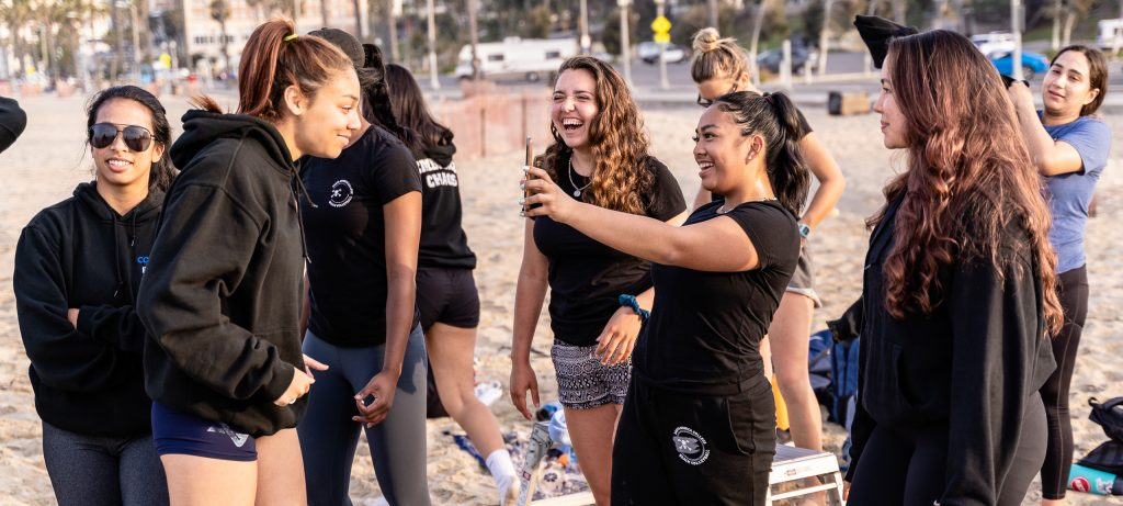 The SMC Beach Volleyball Team Shares A Light Moment Before Practice At Santa Monica Beach On Tuesday, March 26, 2019. The Beach Volleyball Season Began In February And Runs Through April 2019. (Glenn Zucman/The Corsair)